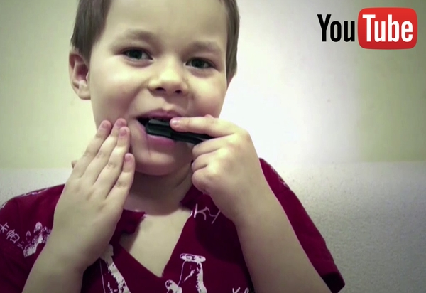 Five year old vargan (jew's harp) player